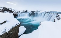Waterfalls in snow, Godafoss, Iceland